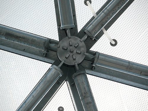 A plug-in knot was developed, which accepted all angles and radii and which could be produced to allow for a degree of tolerance and assembled on site